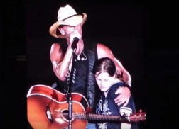 Kenny Chesney Gives Fan A Memorable On-Stage Kiss