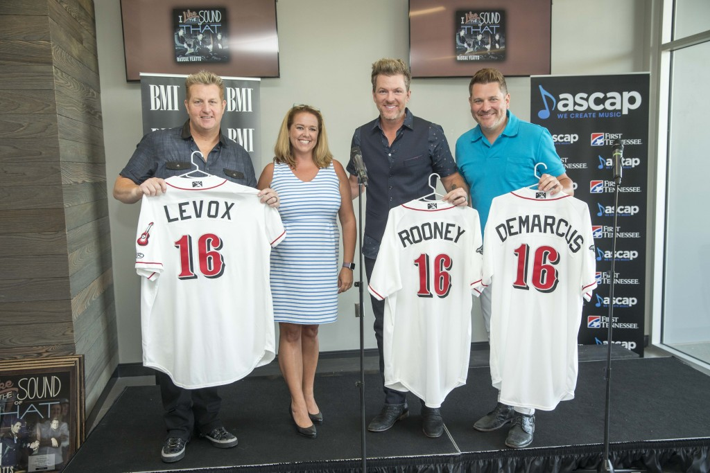 Pictured (L-R): Gary LeVox, Amy Schoch (Nashville Sounds VP Human Resources), Joe Don Rooney, Jay DeMarcus; Photo Credit: John Russell