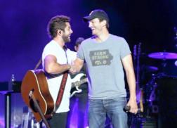Thomas Rhett Sings Garth Brooks Classic with Ashton Kutcher at Concert
