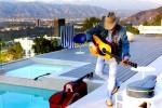 Album Review: Dwight Yoakam's 'Swimmin' Pools, Movie Stars…'