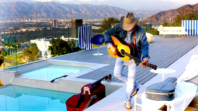 Album Review: Dwight Yoakam's 'Swimmin' Pools, Movie Stars…'