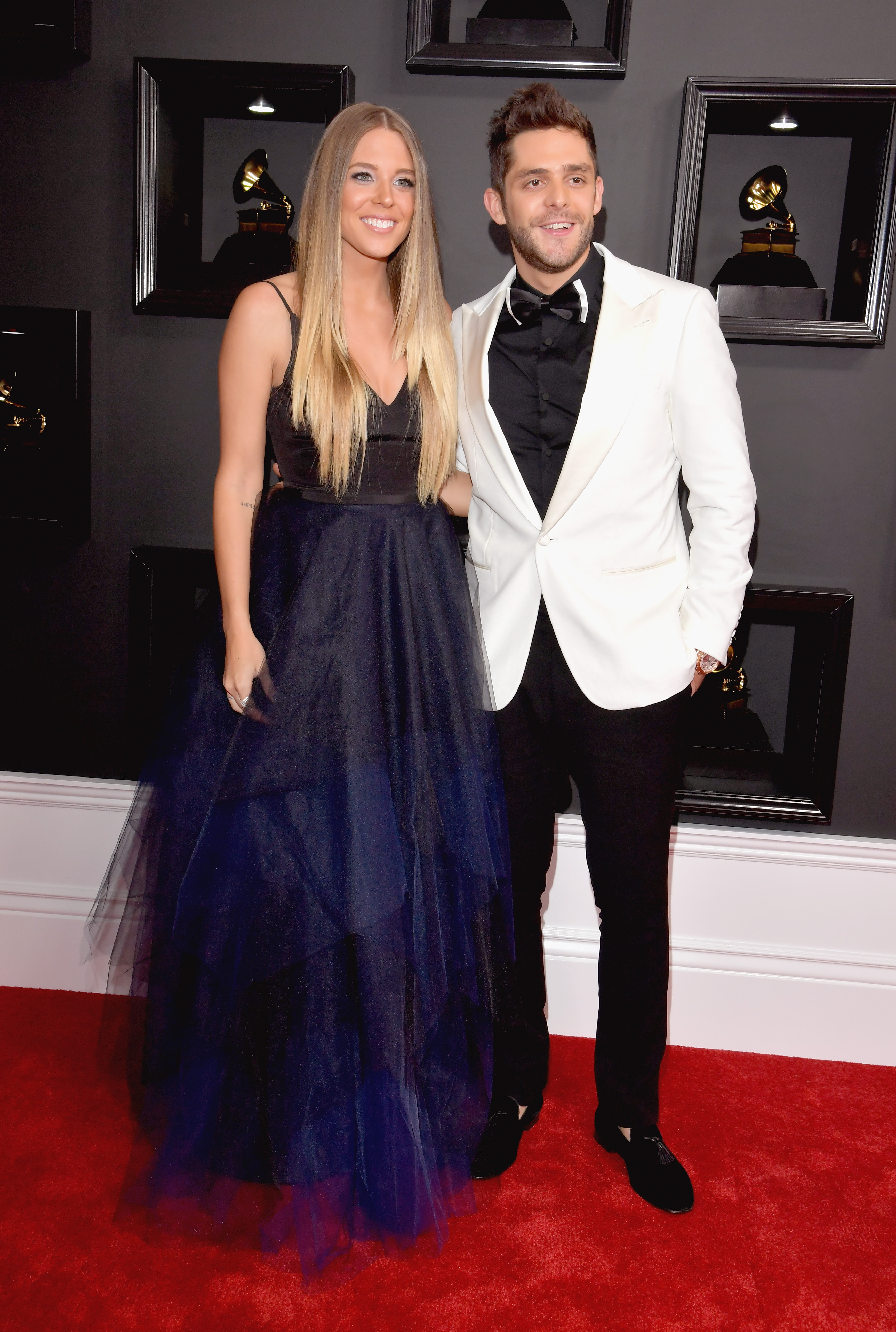 Thomas Rhett and wife Lauren attend The 59th GRAMMY Awards; Photo by Lester Cohen/WireImage