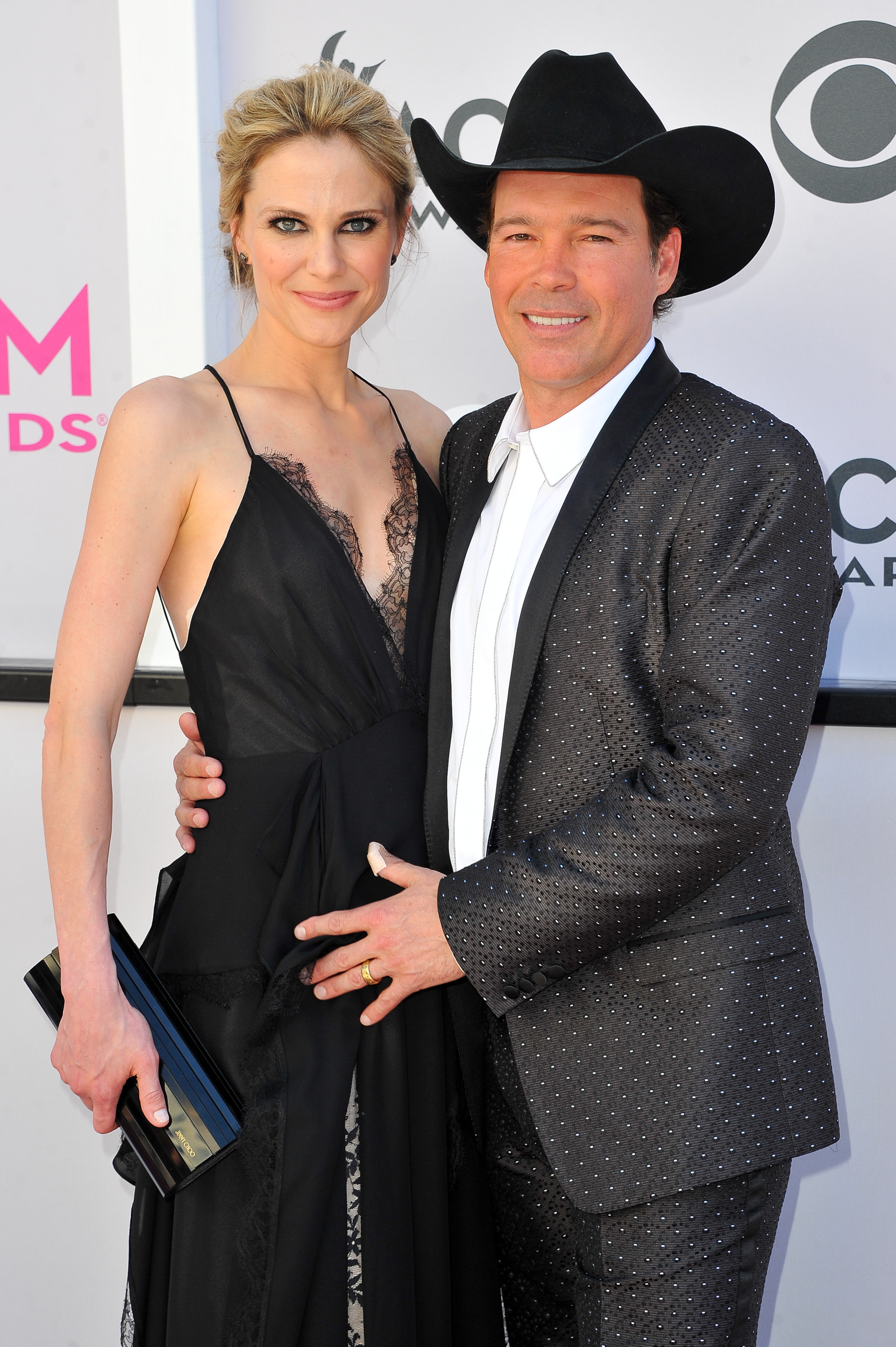 Jessica Craig and Clay Walker; Photo by Allen Berezovsky/WireImage for Fashion Media