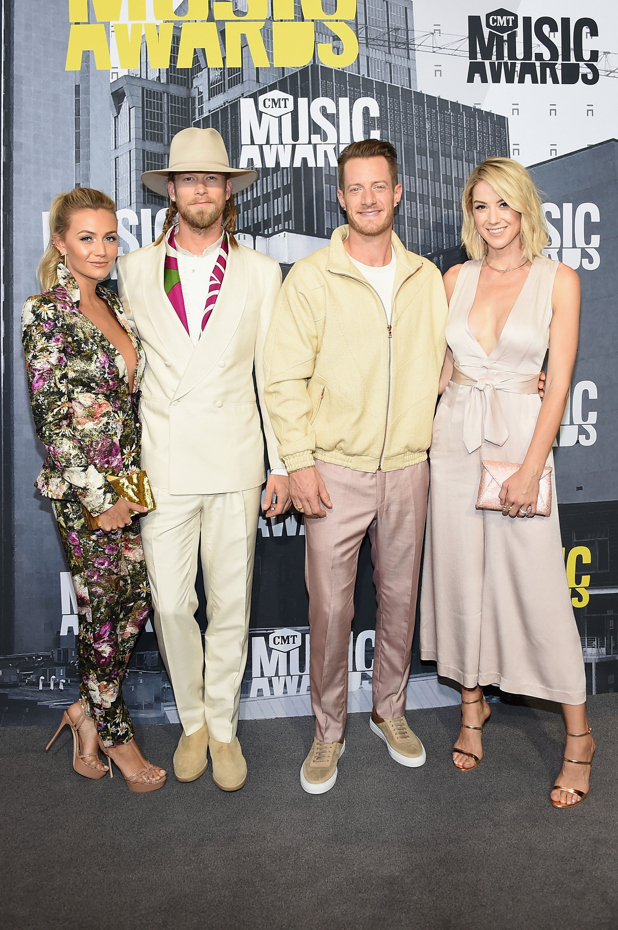 NASHVILLE, TN - JUNE 07: (L-R) Brittney Marie Cole, singers Brian Kelley and Tyler Hubbard of music group Florida Georgia Line, and Hayley Stommel attend the attend the 2017 CMT Music Awards at the Music City Center on June 7, 2017 in Nashville, Tennessee. (Photo by Michael Loccisano/Getty Images For CMT)