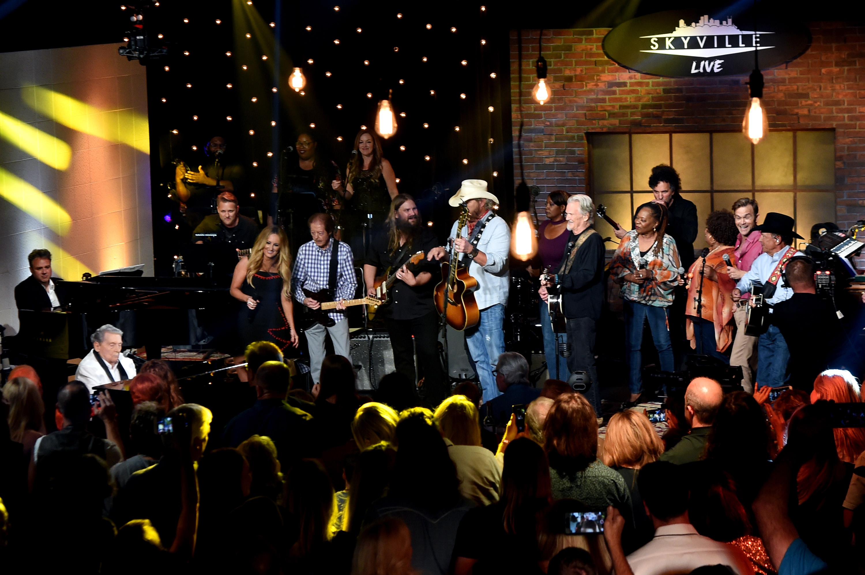 Jerry Lee Lewis, Lee Ann Womack, Chris Stapleton, Toby Keith, Kris Kristofferson, Waylon Payne, and George Strait; Photo by Rick Diamond/Getty Images for Skyville