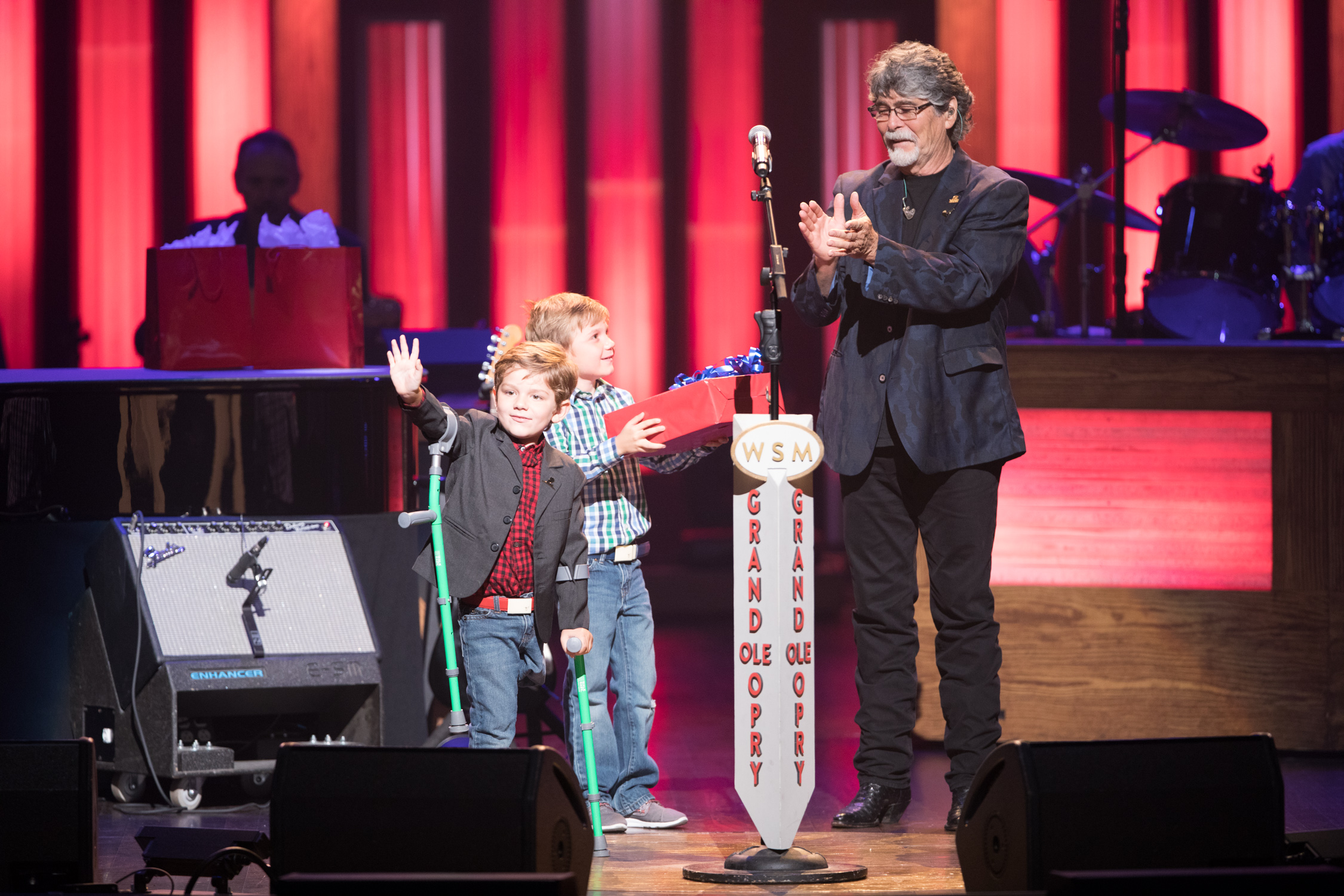 Alabama's Randy Owen with St. Jude patient Kael; Photo credit: Chris Hollo/Grand Ole Opry