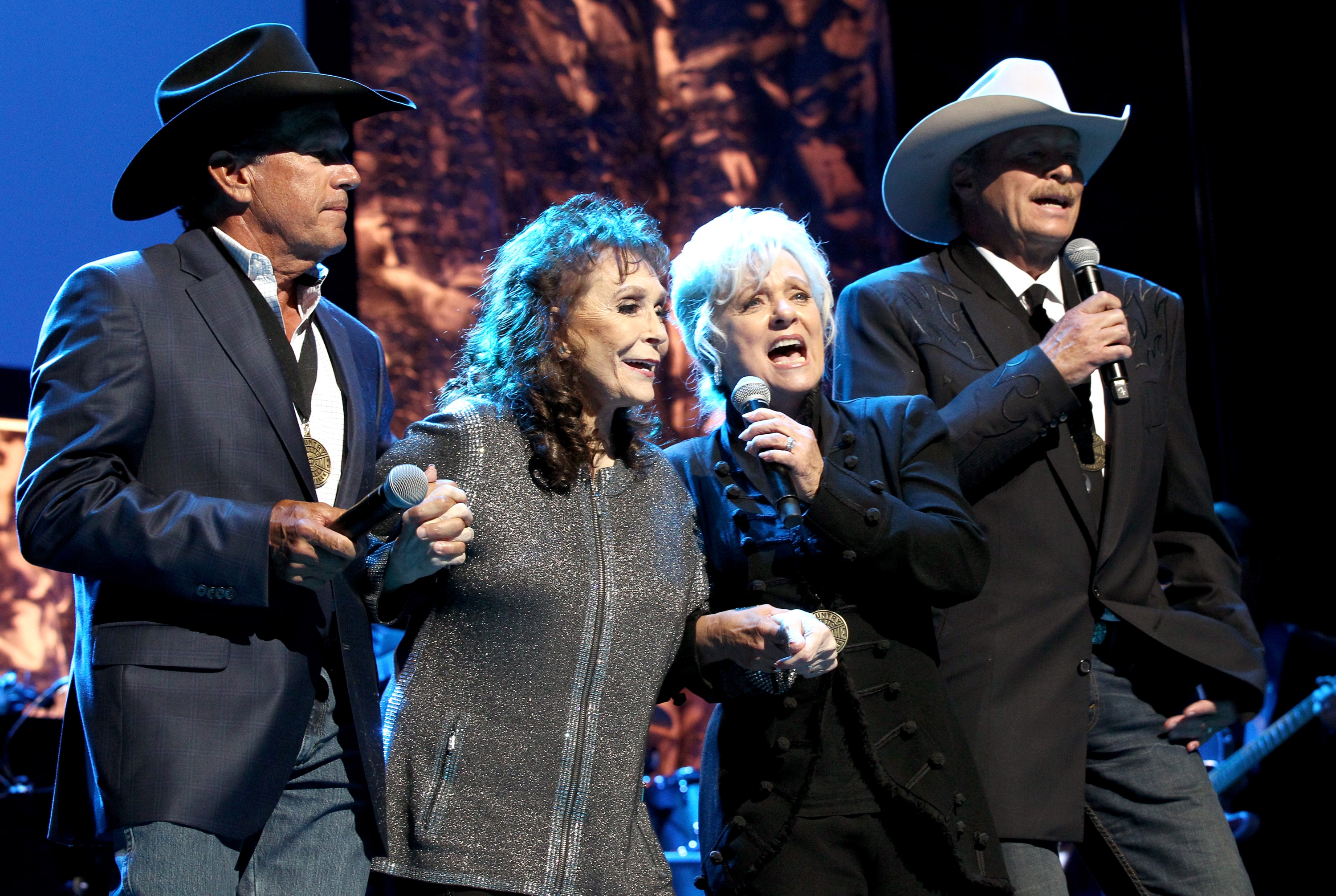 Musicians George Strait, Loretta Lynn, Connie Smith and Alan Jackson perform onstage at the Country Music Hall of Fame and Museum Medallion Ceremony; Photo by Terry Wyatt/Getty Images for Country Music Hall Of Fame & Museum