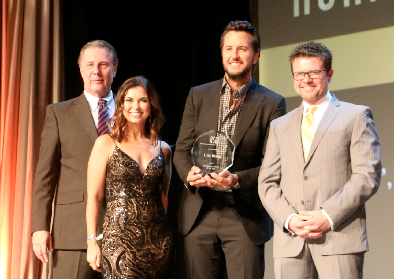 NSAI Songwriter-Artist of the Year Luke Bryan receiving his award from NSAI Executive Director Bart Herbison, NSAI Director of Operations Jennifer Turnbow and NSAI President Lee Thomas Miller; Photo by Bev Moser