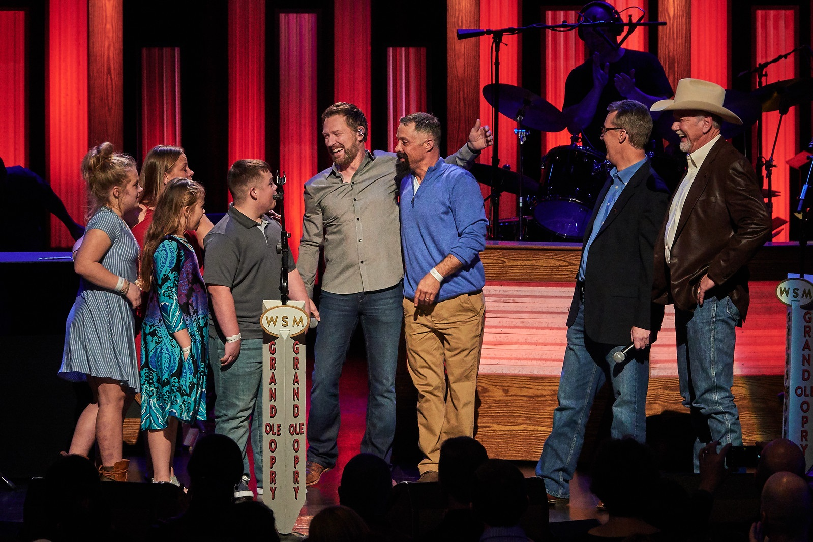 Craig Morgan surprises his friend, U.S. Army SFC Josh Ferguson, and family Friday night at the Grand Ole Opry with the news they are receiving a custom-built, mortgage-free home in Dickson County (Tennessee) from Operation FINALLY HOME. Joining Craig and the Ferguson family on stage were Operation FINALLY HOME Founder Dan Wallrath and Executive Director Rusty Carroll. Photo Credit: Rick Stufflebean - 501concepts
