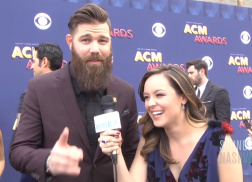 Hayley Orrantia Brings Laughs and Games to the ACM Red Carpet