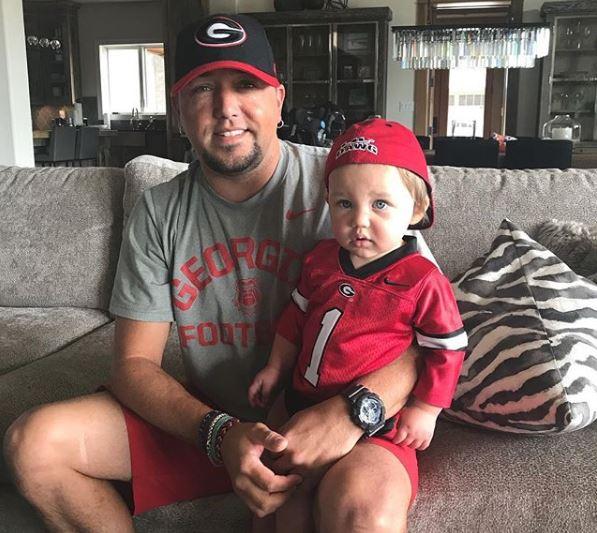 6ef9cbed56f93 Jason Aldean and Mini-Me Son Catch Georgia Bulldogs Football Game. Memphis   first words will ...