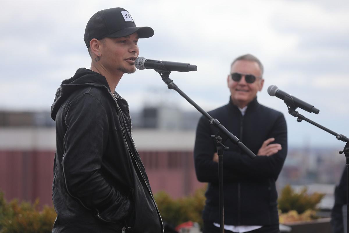 Kane Brown talks about his new album as Sony Music Nashville Chairman & CEO Randy Goodman looks on. Photo credit: Alan Poizner