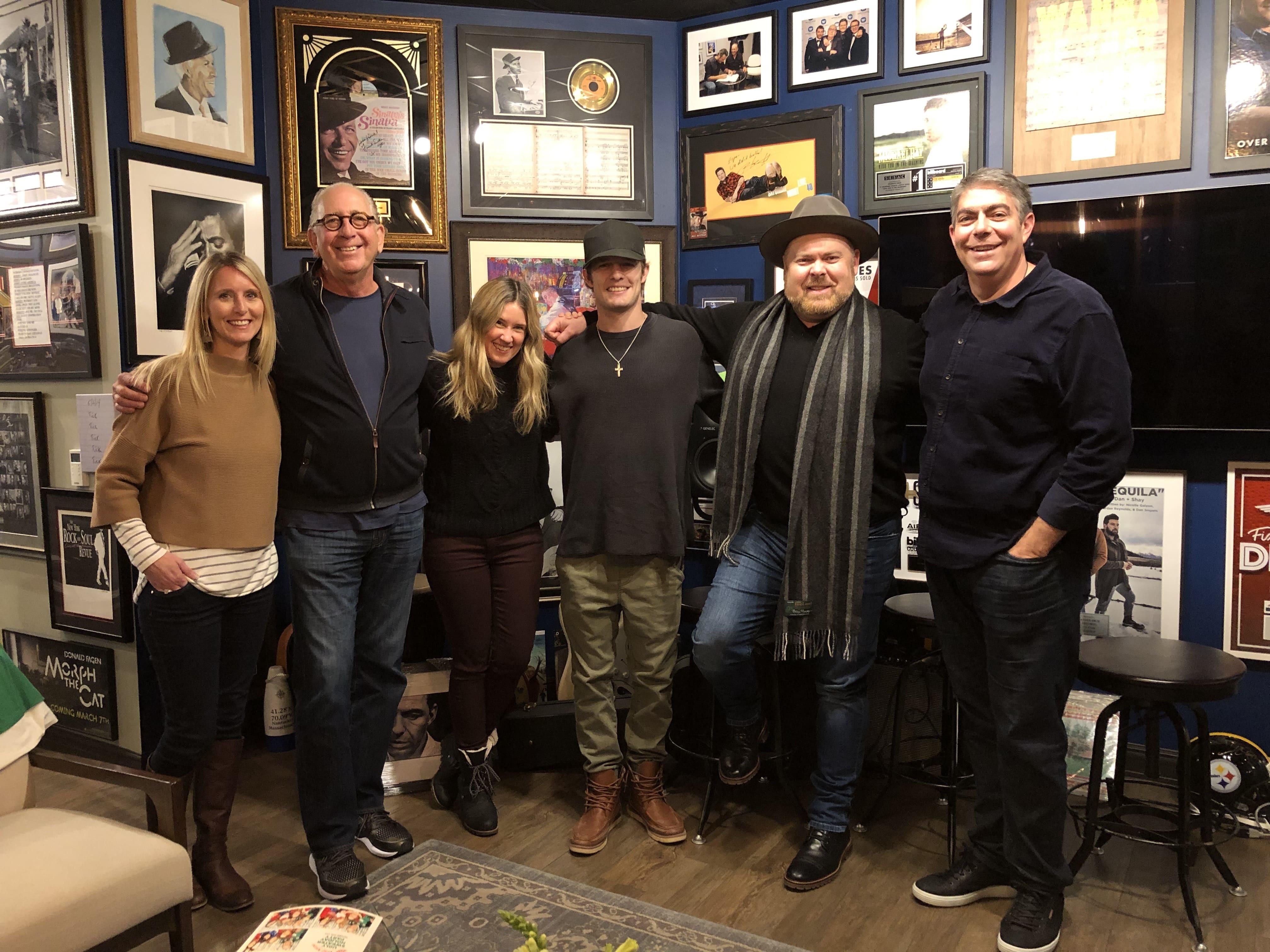 Photo ID (L-R): Kristen Williams (SVP Radio & Streaming); John Esposito (Chairman & CEO); Cris Lacy (SVP A&R); Tucker Beathard; Shane Tarleton (SVP Artist Development); Matt Signore (COO)