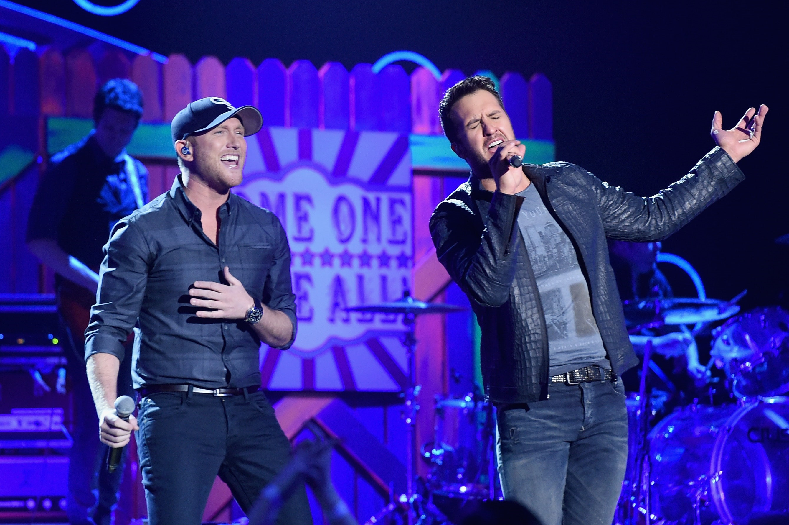 NASHVILLE, TN - DECEMBER 15: Recording artists Cole Swindell (L) and Luke Bryan perform onstage during 2014 American Country Countdown Awards at Music City Center on December 15, 2014 in Nashville, Tennessee. (Photo by Jason Merritt/Getty Images for dcp)