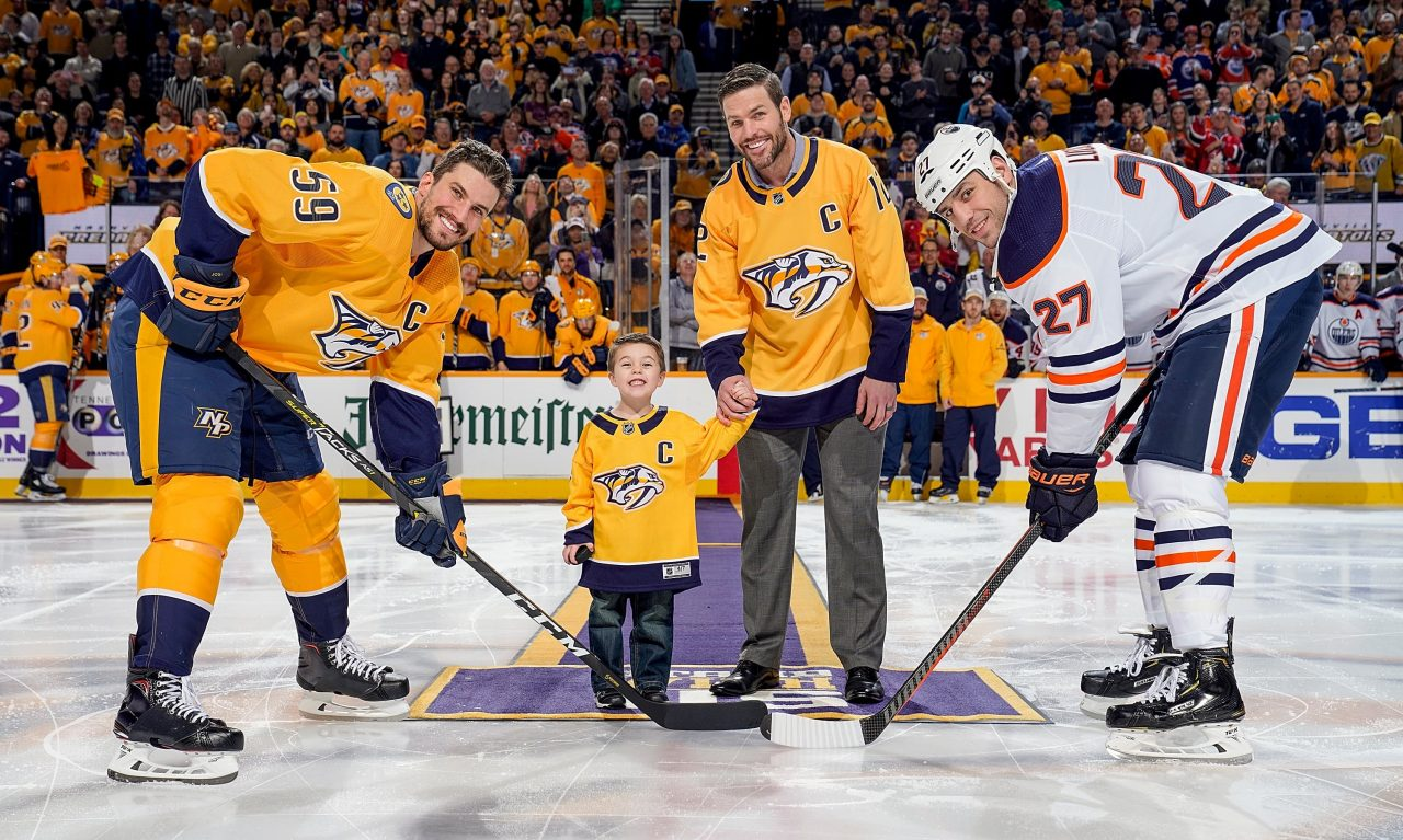 Carrie Underwood's Husband Mike Fisher and Son Isaiah Drop Puck at Nashville Predators Game
