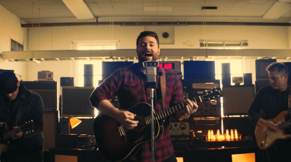 "Chris Young Storms a Famous Radio Studio in ""Raised On Country"" Video"