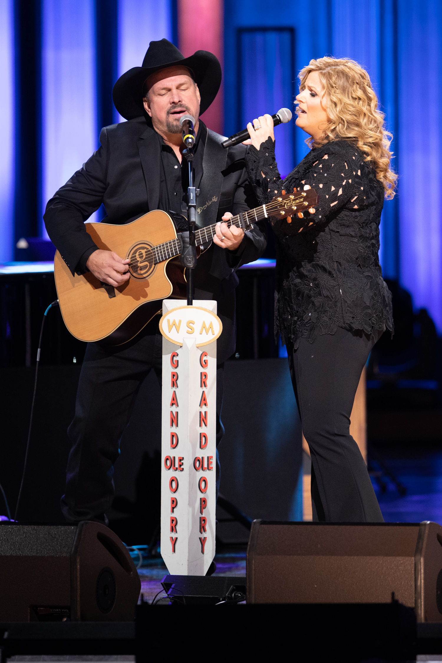 """Garth Brooks joins Trisha Yearwood onstage for her 20th Anniversary celebration to perform """"Whiskey to Wine."""""""