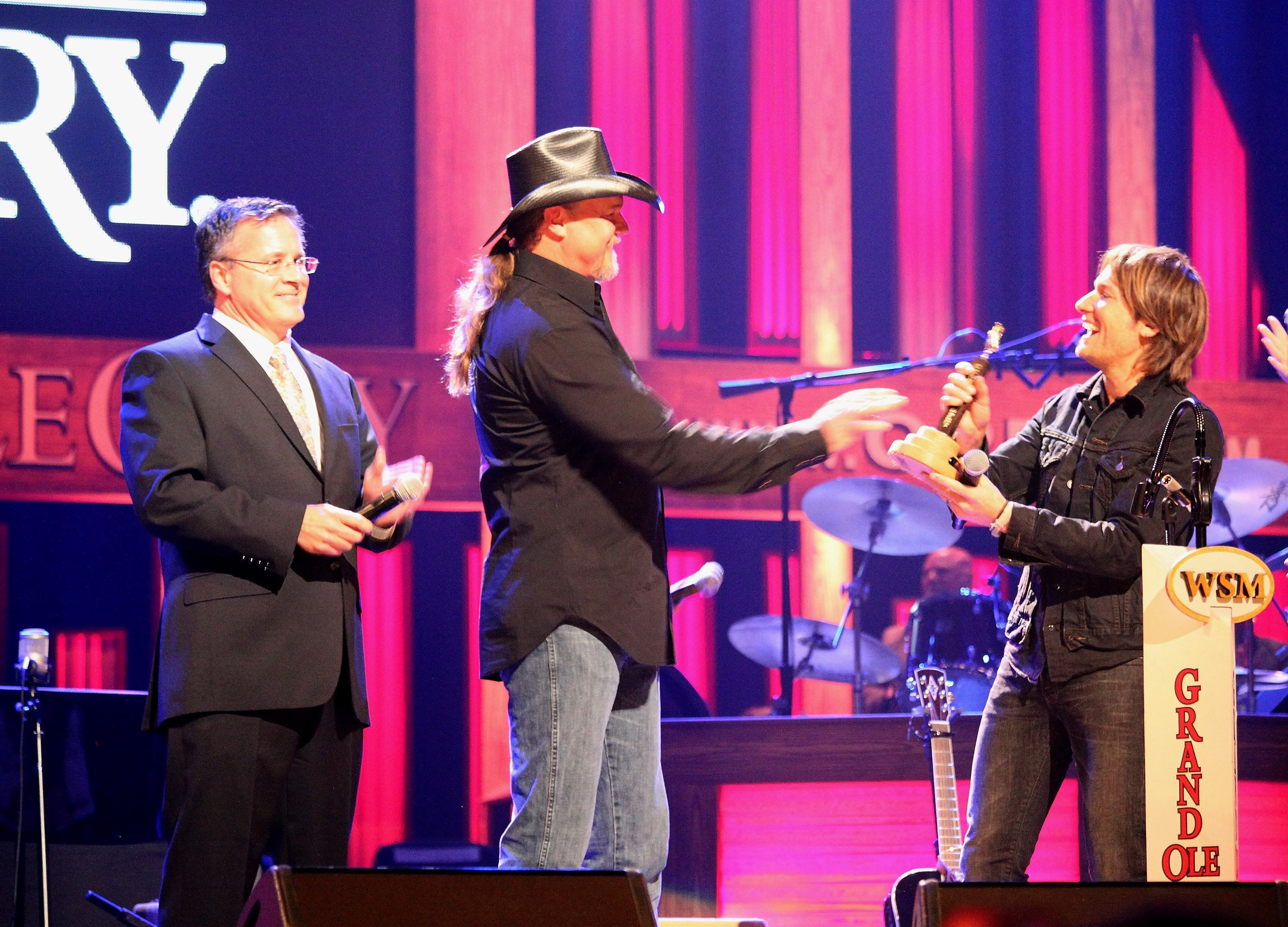 NASHVILLE, TN - APRIL 21: Pete Fisher, Grand Ole Opry Vice President and General Manager, and Trace Adkins inducts Keith Urban into The Grand Ole Opry on April 21, 2012 in Nashville, Tennessee. (Photo by Tony R. Phipps/WireImage)