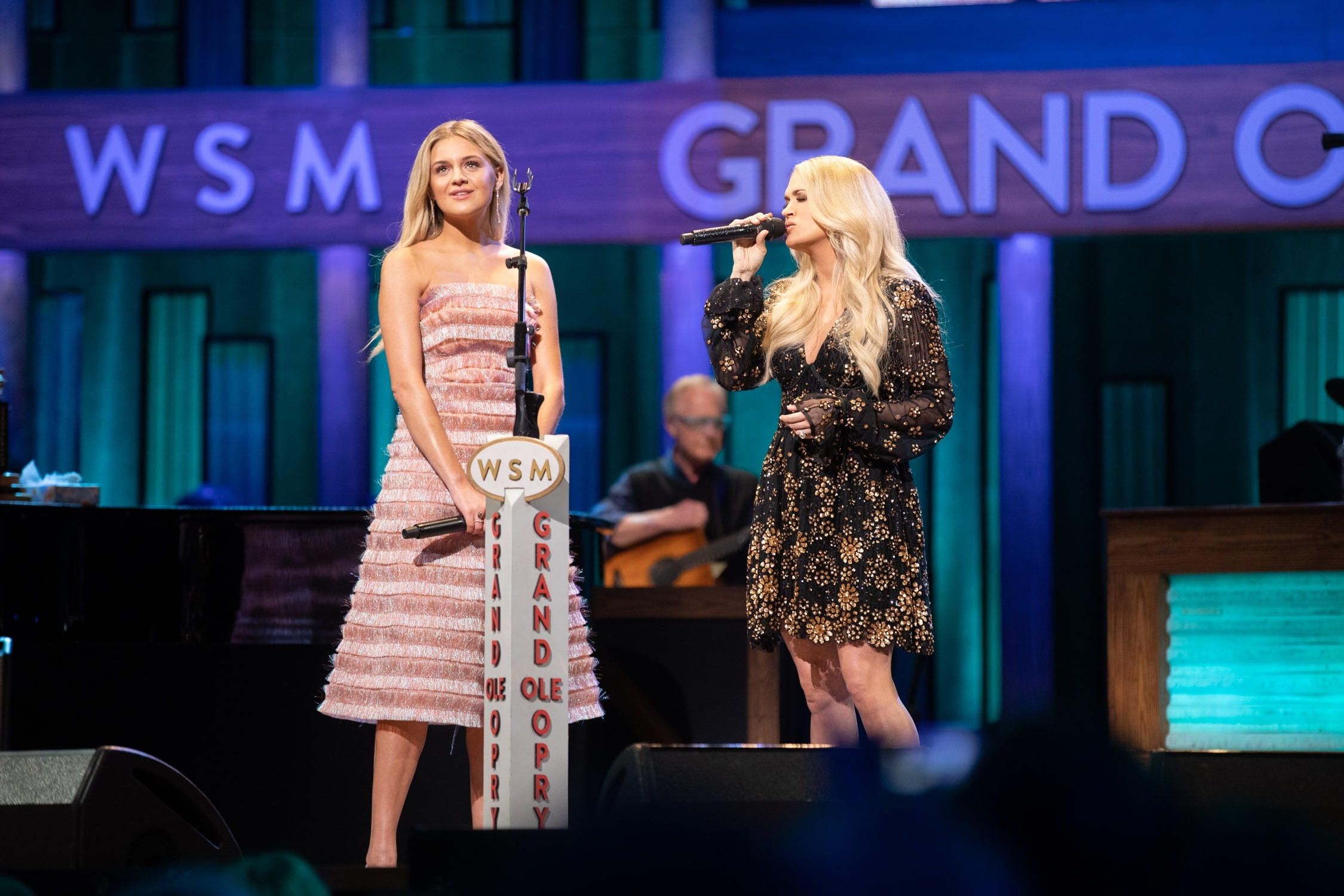 Kelsea Ballerini and Carrie Underwood; Photo courtesy Grand Ole Opry LLC. Chris Hollo, photographer