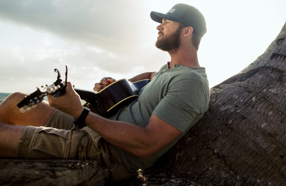 Riley Green Brings Music City to Belize for 'In Love By Now' Video