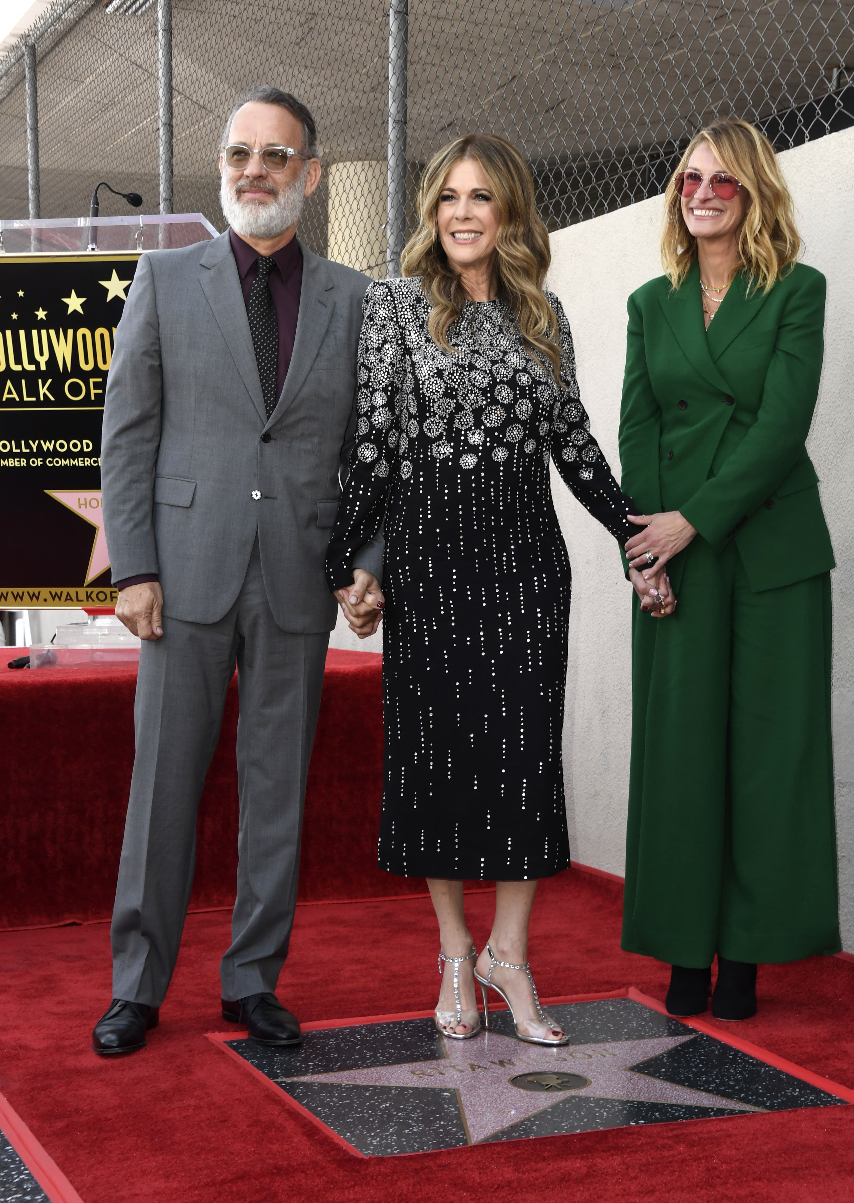 HOLLYWOOD, CALIFORNIA - MARCH 29: (L-R): Tom Hanks, wife Rita Wilson, and Julia Roberts stand on Wilson's newly unveiled star after she was honored on the Hollywood Walk of Fame in Hollywood,, California on March 29, 2019.