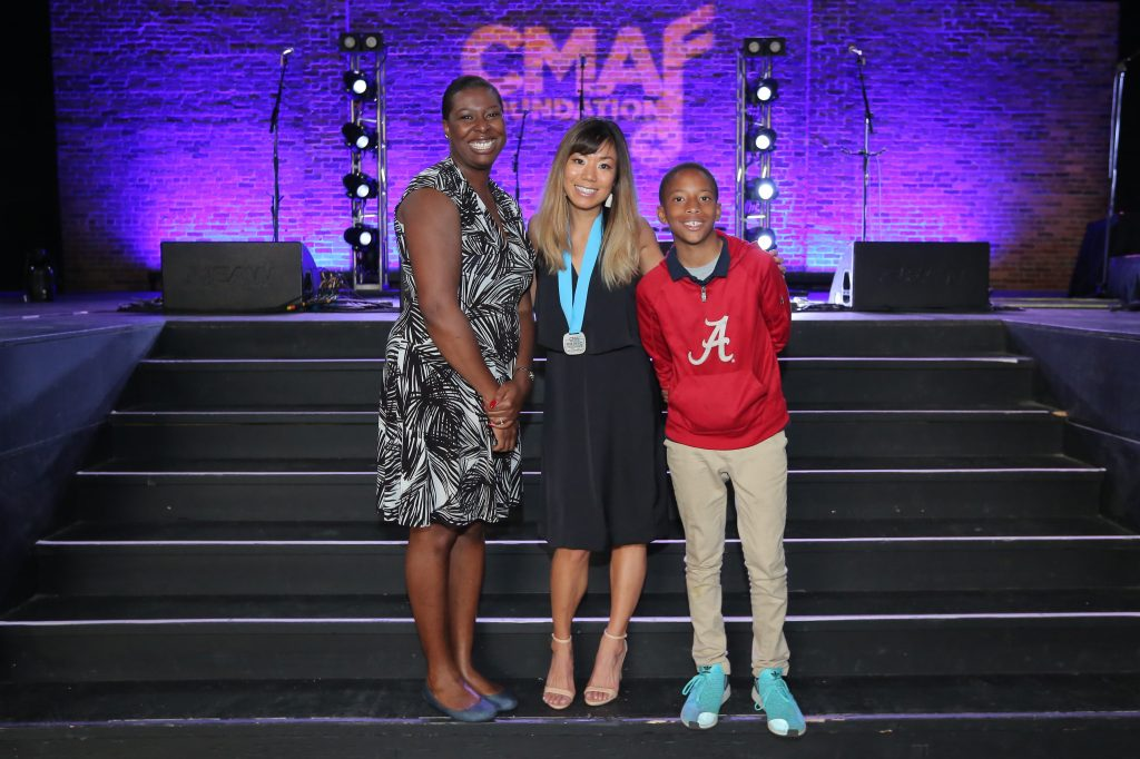 (L-R): Aundra Keo Brown, Alice Asako Walle (CMA Music Teacher of Excellence) and Zion Brown gather following the CMA Foundation's Music Teachers of Excellence event on Tuesday, April 30 at Marathon Music Works in Nashville; Photo Credit: Kayla Schoen/CMA