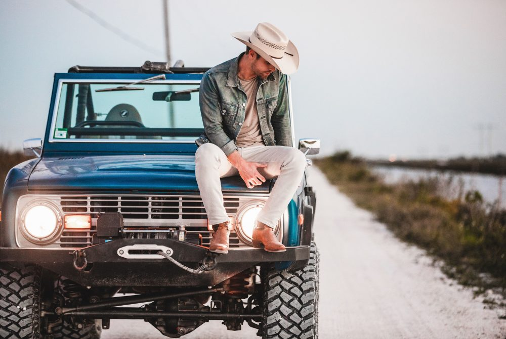Dustin Lynch Takes a Steamy Visual Thrill Ride in 'Ridin' Roads' Video
