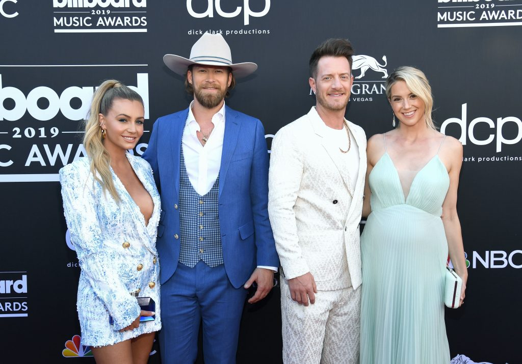 LAS VEGAS, NV - MAY 01: (L-R) Brittney Marie Cole, Brian Kelley and Tyler Hubbard of Florida Georgia Line, and Hayley Stommel attend the 2019 Billboard Music Awards at MGM Grand Garden Arena on May 1, 2019 in Las Vegas, Nevada. (Photo by Kevin Mazur/Getty Images for dcp)
