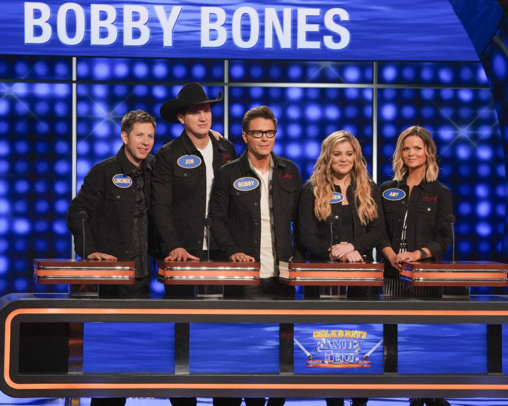 "CELEBRITY FAMILY FEUD - ""Brooklyn Decker & Andy Roddick vs. Bobby Bones and Tara Lipinski vs. Johnny Weir"" - Actress and tech entrepreneur Brooklyn Decker and her husband, Andy Roddick, a former world No. 1 professional tennis player, will compete against nationally syndicated on-air personality Bobby Bones, who has previously been seen on Season 2 of ABC's ""American Idol"" as the official in-house mentor and was season 27 ""Dancing with the Stars"" Champion, to win cash for their charities. The next game of the night features Olympic figure skater Tara Lipinski facing off against two-time Olympic figure skater Johnny Weir, along with members of their respective families on a star-studded episode of ""Celebrity Family Feud,"" airing SUNDAY, JULY 21 (8:00-9:00 p.m. EDT), on ABC. (ABC/Byron Cohen) LUNCHBOX, JON PARDI, BOBBY BONES, LAUREN ALAINA, AMY BROWN"