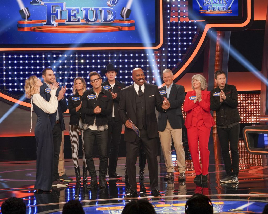 "CELEBRITY FAMILY FEUD - ""Brooklyn Decker & Andy Roddick vs. Bobby Bones and Tara Lipinski vs. Johnny Weir"" - Actress and tech entrepreneur Brooklyn Decker and her husband, Andy Roddick, a former world No. 1 professional tennis player, will compete against nationally syndicated on-air personality Bobby Bones, who has previously been seen on Season 2 of ABC's ""American Idol"" as the official in-house mentor and was season 27 ""Dancing with the Stars"" Champion, to win cash for their charities. The next game of the night features Olympic figure skater Tara Lipinski facing off against two-time Olympic figure skater Johnny Weir, along with members of their respective families on a star-studded episode of ""Celebrity Family Feud,"" airing SUNDAY, JULY 21 (8:00-9:00 p.m. EDT), on ABC. (ABC/Byron Cohen) LUNCHBOX, LAUREN ALAINA, BOBBY BONES, AMY BROWN, JON PARDI"