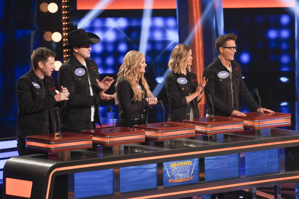"CELEBRITY FAMILY FEUD - ""Brooklyn Decker & Andy Roddick vs. Bobby Bones and Tara Lipinski vs. Johnny Weir"" - Actress and tech entrepreneur Brooklyn Decker and her husband, Andy Roddick, a former world No. 1 professional tennis player, will compete against nationally syndicated on-air personality Bobby Bones, who has previously been seen on Season 2 of ABC's ""American Idol"" as the official in-house mentor and was season 27 ""Dancing with the Stars"" Champion, to win cash for their charities. The next game of the night features Olympic figure skater Tara Lipinski facing off against two-time Olympic figure skater Johnny Weir, along with members of their respective families on a star-studded episode of ""Celebrity Family Feud,"" airing SUNDAY, JULY 21 (8:00-9:00 p.m. EDT), on ABC. (ABC/Byron Cohen) LUNCHBOX, JON PARDI, LAUREN ALAINA, AMY BROWN, BOBBY BONES"
