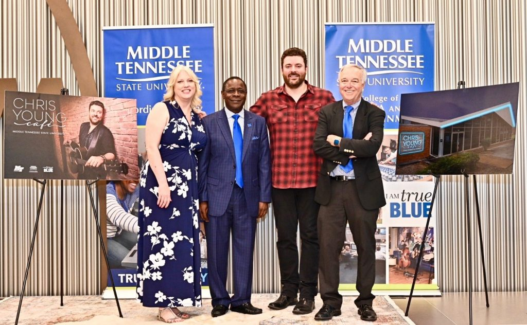 Multi-platinum country artist Chris Young, a former MTSU student (second from right), joins President Sidney A. McPhee (second from left), Media and Entertainment Dean Ken Paulson (right) and Recording Industry Chair Beverly Keel (left) to announce the Chris Young Café, a live performance venue on the Murfreesboro university's campus (MTSU Photo by J Intintoli)