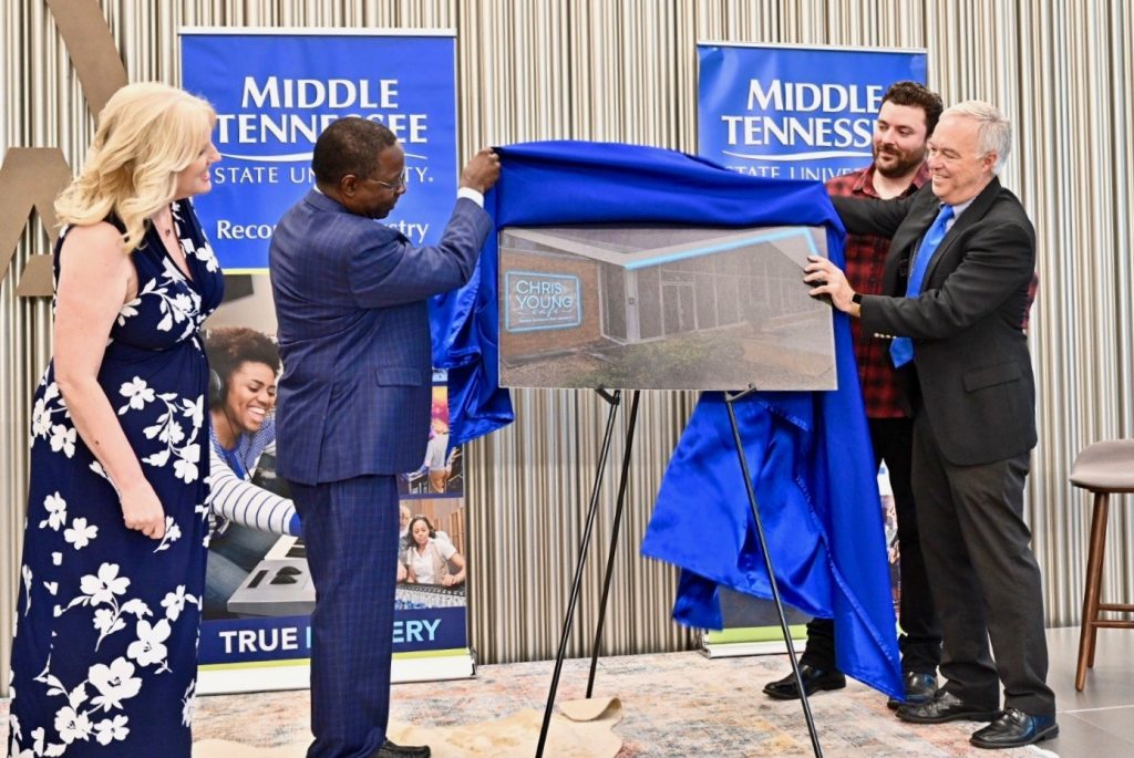Multi-platinum country artist Chris Young, a former MTSU student (right, back), looks on as President Sidney A. McPhee and other university officials unveil the concept rendering for the Chris Young Café, a live performance venue on the Murfreesboro university's campus (MTSU Photo by J Intintoli)