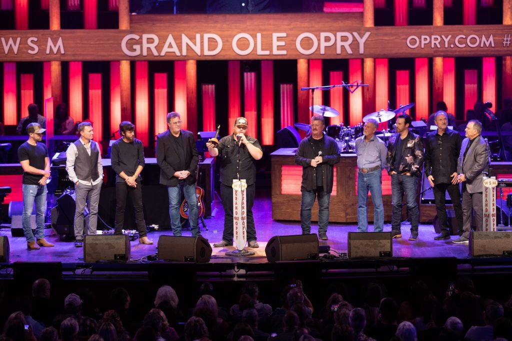 Luke Combs was inducted into the Grand Ole Opry family by Opry members Vince Gill and Joe Diffie. Fellow Opry members The Gatlin Brothers, Chris Janson, Dustin Lynch, Craig Morgan, and Mark Wills joined them onstage to welcome their newest fellow member. Photo By: Chris Hollo/©Grand Ole Opry