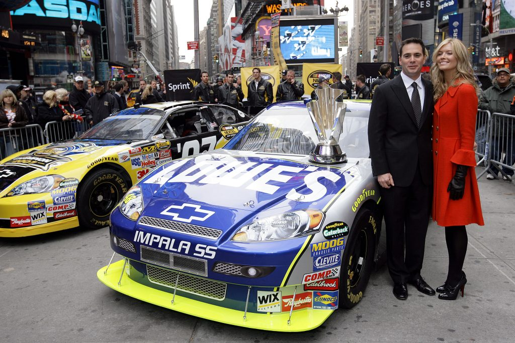 NEW YORK - NOVEMBER 29: Jimmie Johnson Poses with VIPs during NASCAR Champions Week at Military Island in Times Square on November 29, 2007 in New York City. (Photo by Chris Trotman/Getty Images for NASCAR)