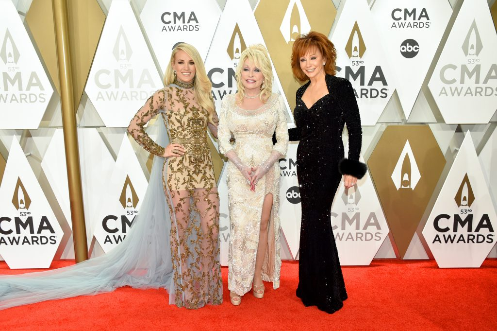 NASHVILLE, TENNESSEE - NOVEMBER 13: (L-R) Carrie Underwood, Dolly Parton and Reba McEntire attend the 53rd annual CMA Awards at the Music City Center on November 13, 2019 in Nashville, Tennessee. (Photo by John Shearer/WireImage,)