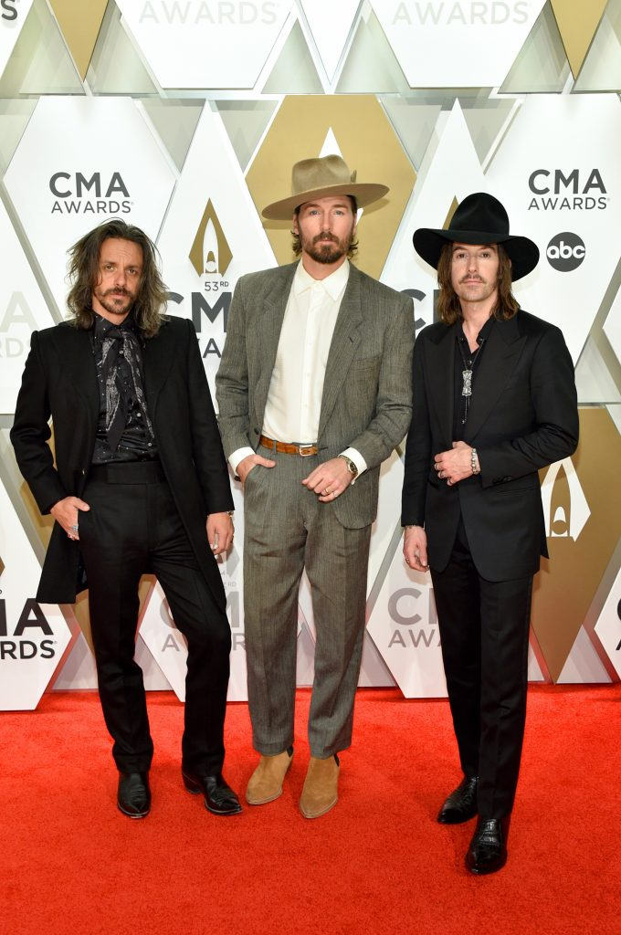NASHVILLE, TENNESSEE - NOVEMBER 13: (L-R) Cameron Duddy, Mark Wystrach, and Jess Carson of Midland attend the 53rd annual CMA Awards at the Music City Center on November 13, 2019 in Nashville, Tennessee. (Photo by John Shearer/WireImage,)