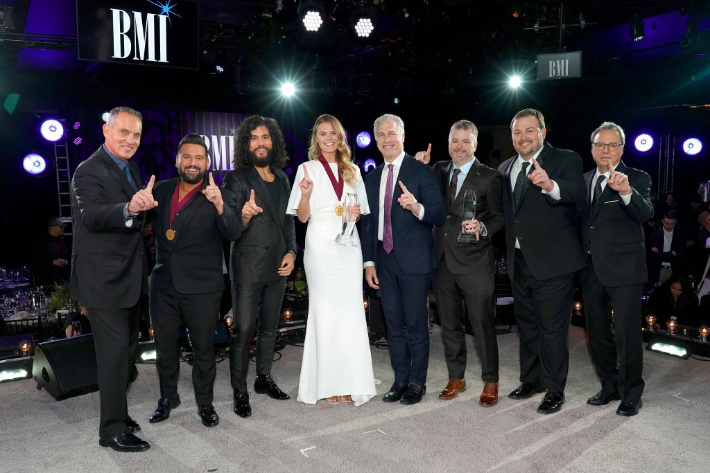 NASHVILLE, TENNESSEE - NOVEMBER 12:  BMI President/CEO Mike O'Neil, Shay Mooney and Dan Smyers of Dan + Shay, Nicolle Galyon, BMI's Mike Steinberg, Warner Chapel's Ben Vaughn, BMI's Mason Hunter and  BMI Vice President, Creative, Jody Williams attend as BMI presents Dwight Yoakam with President's Award at 67th Annual Country Awards Dinner at BMI on November 12, 2019 in Nashville, Tennessee. (Photo by Erika Goldring /Getty Images)