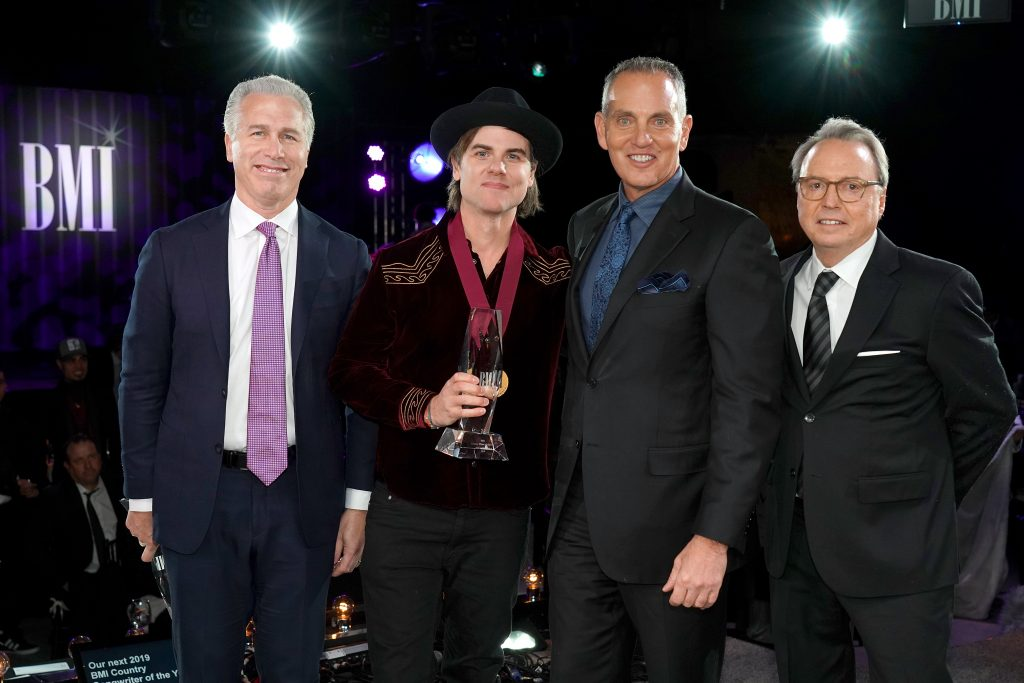 NASHVILLE, TENNESSEE - NOVEMBER 12: (L-R) BMI's Mike Steinberg, Ross Copperman, BMI President/CEO Mike O'Neill, and BMI Vice President, Creative, Jody Williams attend as BMI presents Dwight Yoakam with President's Award at 67th Annual Country Awards Dinner at BMI on November 12, 2019 in Nashville, Tennessee. (Photo by Erika Goldring /Getty Images)