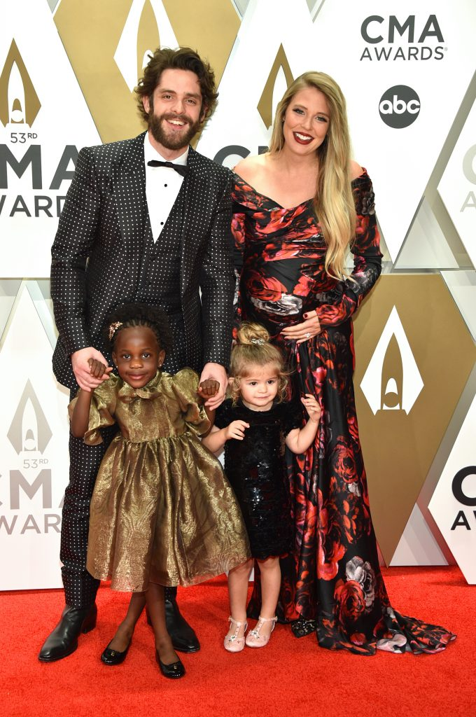 NASHVILLE, TENNESSEE - NOVEMBER 13: (L-R) Willa Gray Akins, Thomas Rhett, Ada James Akins and Lauren Akins attend the 53rd annual CMA Awards at the Music City Center on November 13, 2019 in Nashville, Tennessee. (Photo by John Shearer/WireImage,)