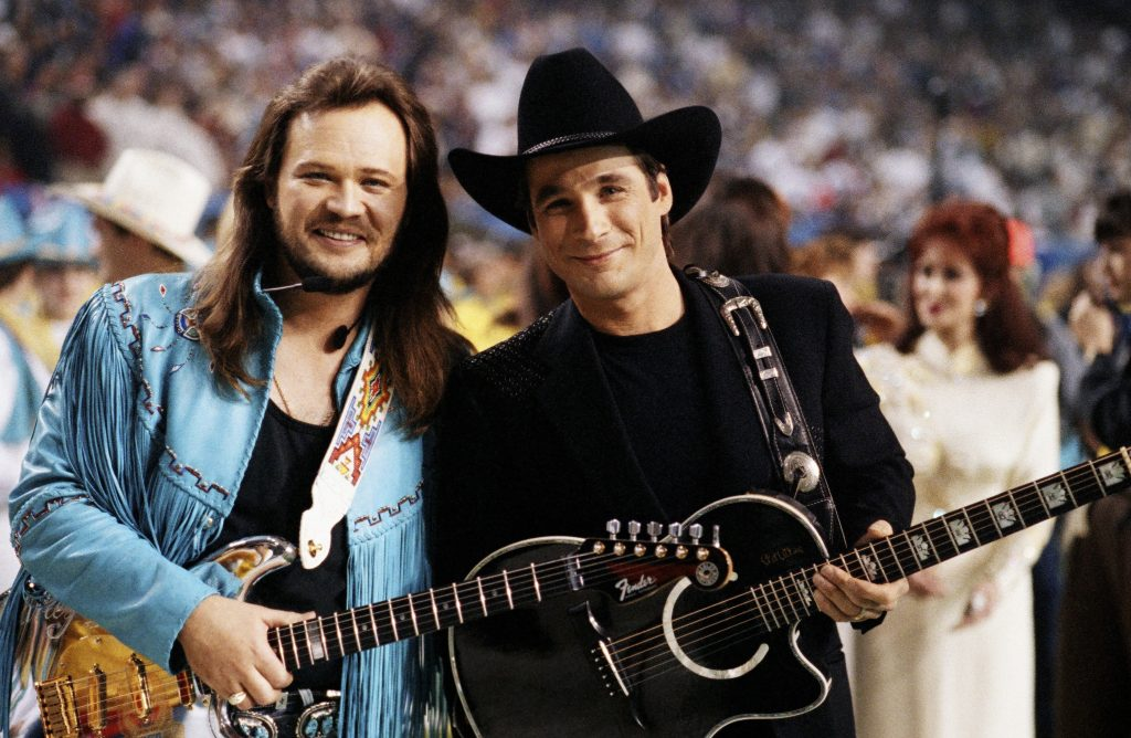 ATLANTA, GA - 1994: Country singer Travis Tritt (left) and Clint Black pose together before the half-time show at the 1994 Atlanta, Georgia, Superbowl XXVII football game held at the Georgia Dome. (Photo by George Rose/Getty Images)