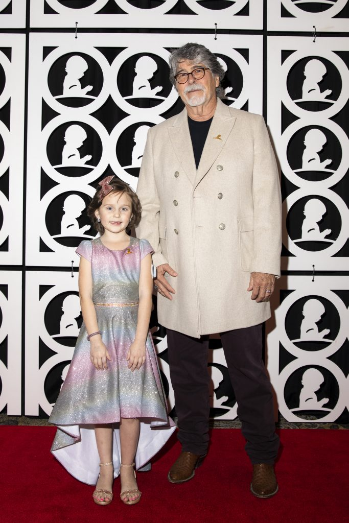 MEMPHIS, TN - JANUARY 17: Randy Owen of Alabama poses on the red carpet with St. Jude patient Londyn during Country Cares for St. Jude Kids Seminar at The Peabody on January 17, 2020 in Memphis, Tennessee. (Photo by Brett Carlsen/Getty Images for St. Jude Children's Research Hospital)