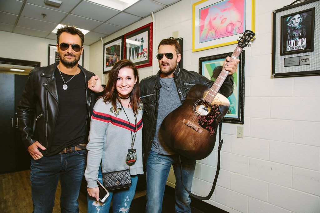 Ebie McFarland and Eric Church with his wax figure; Photo credit: Reid Long