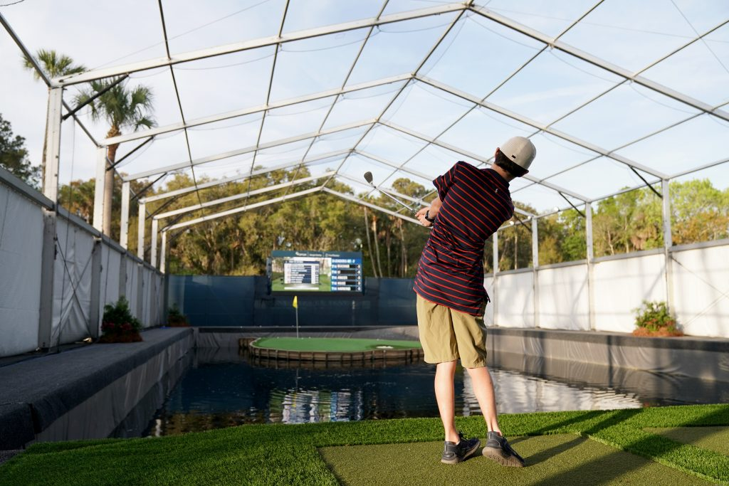 PONTE VEDRA BEACH, FL - MARCH 15: A young fan takes a shot on the 17th Hole Challenge during the second round of THE PLAYERS Championship on THE PLAYERS Stadium Course at TPC Sawgrass on March 15, 2019, in Ponte Vedra Beach . (Photo by Darren Carroll/PGA TOUR)