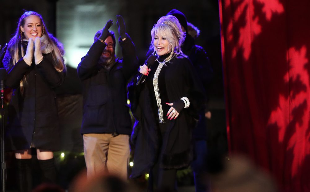 Dolly Parton Drops Cheeky Christmas Favorite, 'I Saw Mommy Kissing Santa Claus'