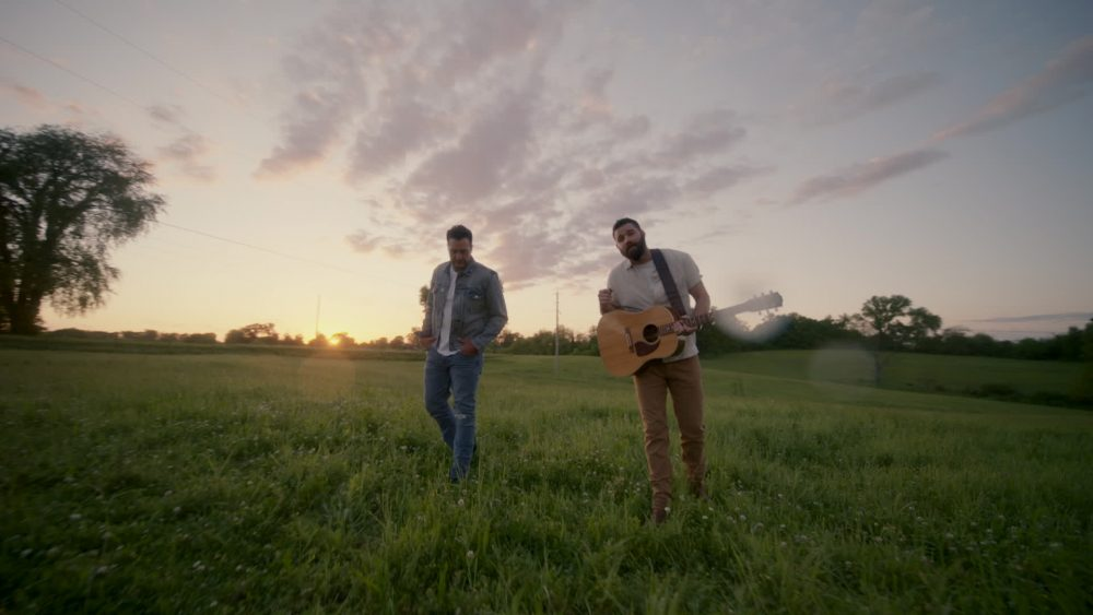 Jordan Davis and Luke Bryan Find Simple Serenity in 'Buy Dirt' Video