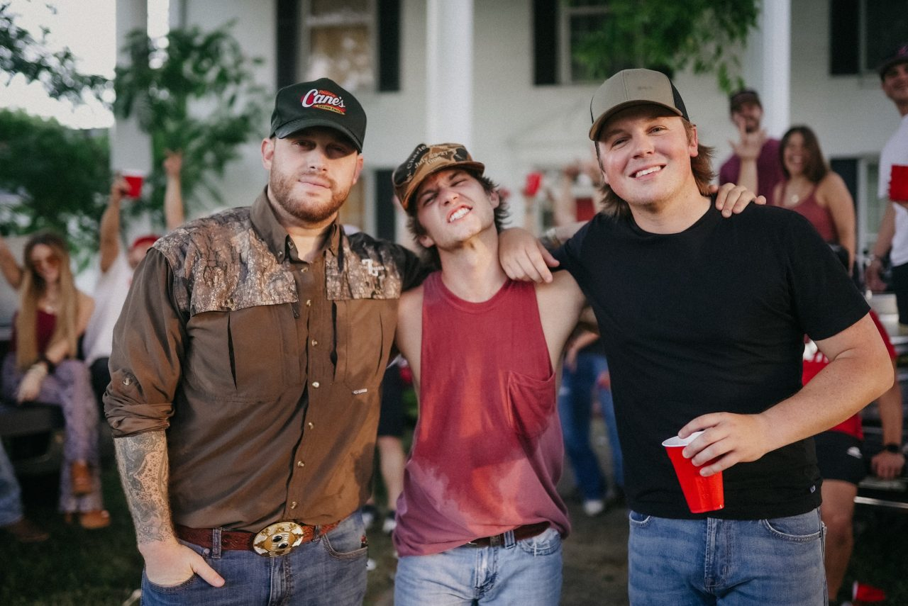Noah Hicks, Jon Langston and Travis Denning Throw Riotous Party In 'Drinkin' In A College Town' Video